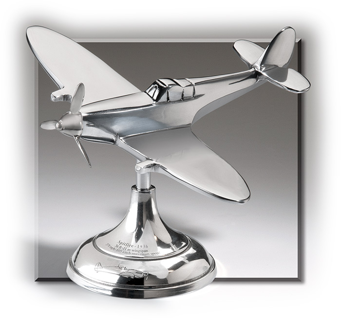 Small replica of a Trench Art Spitfire plane - made from polished aluminum.