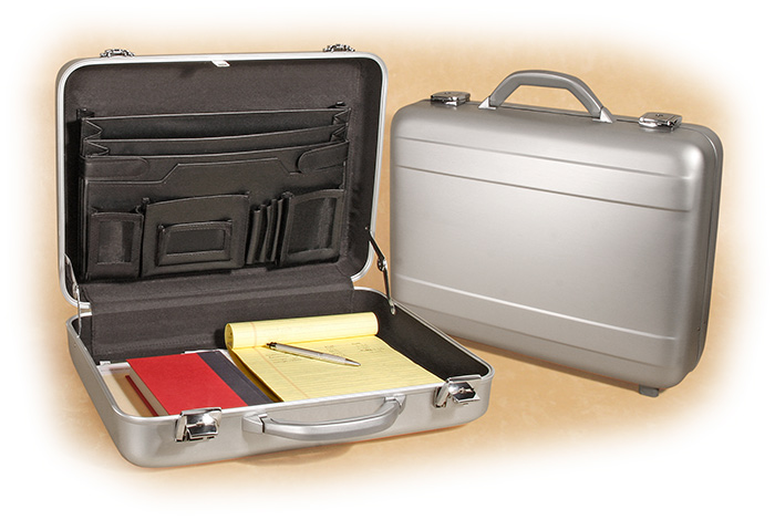 Silver aluminum molded attache with faux leather organizer on the inside